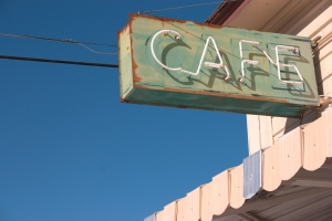 rusted-neon-green-and-white-cafe-sign-1337952-m.jpg